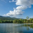 White clouds on blue sky and bright in the reservoir — Stock Photo