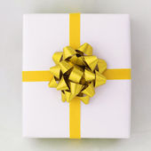 Gold star and Cross line ribbon on White paper box — Photo