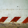 Stock Photo: Tilted red line on white wall