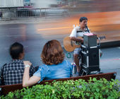 Playing guitar, singing blind beggar in the street car — Photo