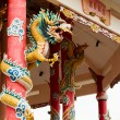 图库照片: Left Golden gragon statue on red pillar