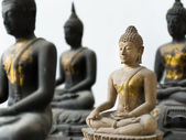Light Stone Buddha focus and Three Dark out — Stock Photo