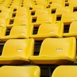 Yellow Empty plastic seats at stadium — Stock Photo #8394617