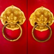 Door handle developing Chinese traditional golden head lion - Stock Photo