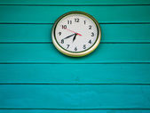 White clock on Green wall — Stock Photo
