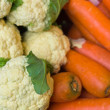 Cauliflower and carrots in the market - Stock Photo