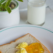 Bread butter jam on white plate — Stockfoto