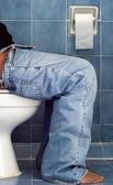 Man sit in Blue bathroom — Stock Photo