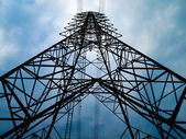 Silhouette front view of high voltage tower — Stock Photo