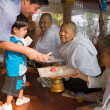Unidentified Cambodian adults and children to donate money to th — Foto de Stock
