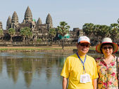 Two unidentified Traveler stand for photo at Angkor Wat — Photo