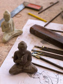 Buddha sculpture and drawing and tools to work — Zdjęcie stockowe