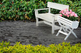 White wood chair on floor in garden — Stock Photo