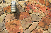 Lamp on stone wall — Stock Photo