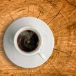 White cup of coffee on wood — Stok fotoğraf