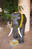 Figure of elephant with offerings. — Stock Photo