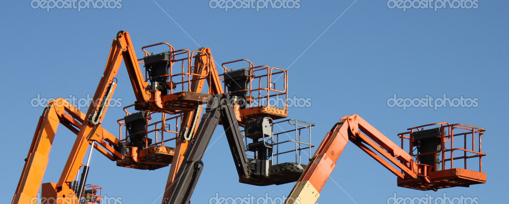 A Group of Mechanical Cherry Picker Lifts. — Stock Photo #10351596