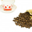 The coffee beans and a coffee cup — Stock Photo