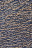 Zand op de zonsondergang licht — Stockfoto