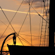 Silhouette of a lifeboat on the big sailboat at sunset — Stock Photo