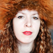 Beautiful woman in fur hat — Stock Photo