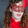 Young lady in a red mask — Stock Photo