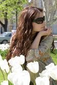 Girl in white tulips — Stock Photo