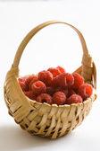 Raspberries in a basket — Stock Photo
