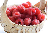 Raspberries in a basket — Stock Photo