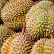 Durians at market — Stock Photo