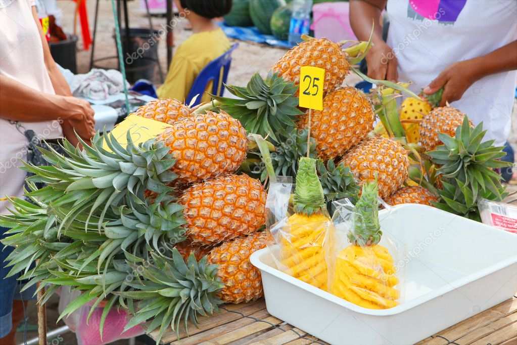 Pineapples on outdoor fruit market, Phuket, Thailand  Stock Photo #10123706