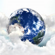 Blue planet in clouds. ecology concept — Stock Photo