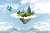 Modern city in clouds. business concept — Stock Photo