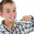 Beautiful little boy cleans your teeth - Stock Photo