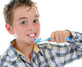 Beautiful little boy cleans your teeth — Stock Photo