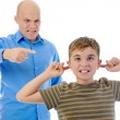 Stock Photo: Strict father punishes his son