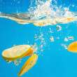 YELLOW citrus SPLASHING IN WATER — Stock Photo #9124741