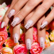 Stock Photo: Beautiful nails with Art