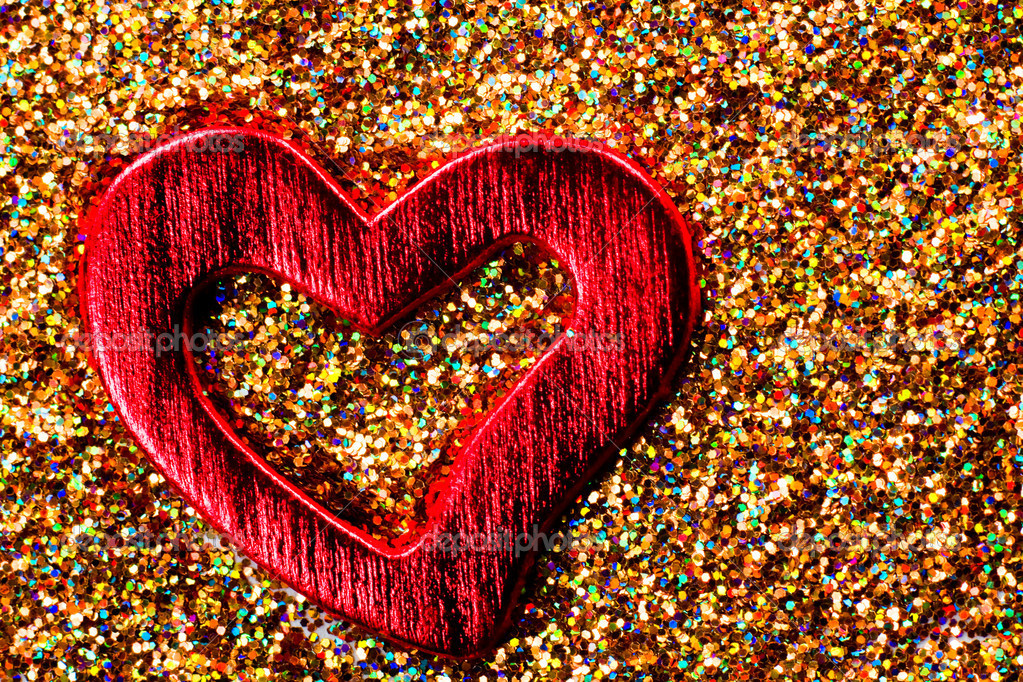 Red shiny heart against the background of tinsel  Foto Stock #9124664