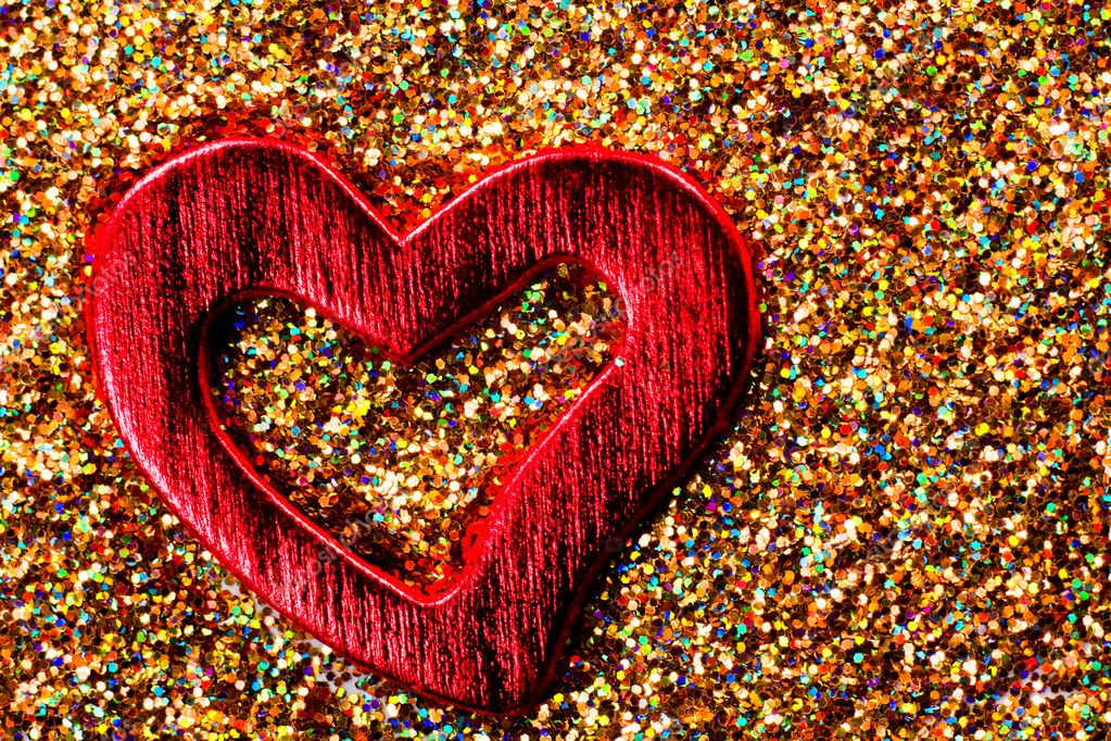 Red shiny heart against the background of tinsel — Stock Photo #9124664