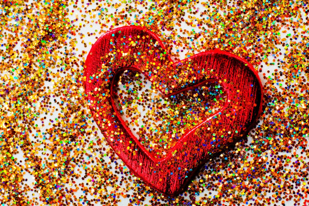 Red shiny heart against the background of tinsel — Stock Photo #9124675