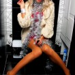 Stock Photo: Sexy girl in nightclub toilet