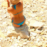 Sexy blond girl on the beach — Stock Photo #9173609