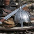 The helmet and sword on a shield - Stock Photo