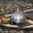 Stock Photo: The helmet and sword on a shield