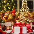 Stock Photo: Festive table setting with red ribbon gift