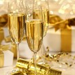 Glass of champagne against sparkle background — Stock Photo