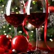 Holiday background with glasses of red wine - Stock Photo