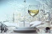 Festive dinner setting with gift for the holidays — Stock Photo