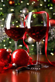 Holiday background with glasses of red wine — Stock Photo